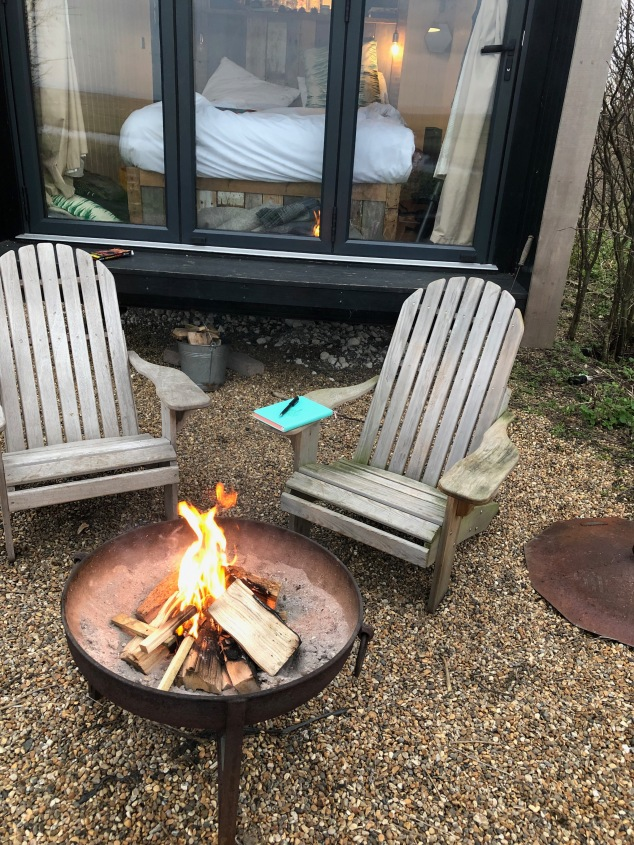 Morning journal writing by the fire